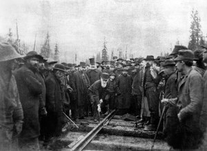 Hon. Donald A. Smith driving the last spike to complete the Canadian Pacific Railway on November 7, 1885. Photo credit: Alexander Ross/Library & Archives Canada