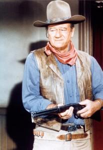 John Wayne, in the film The War Wagon, 1967. © Item/Alamy Images