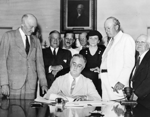 Roosevelt signs Social Security Bill. Credit: Library of Congess